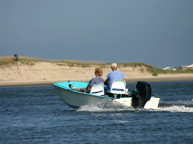 Seniors boating stock images