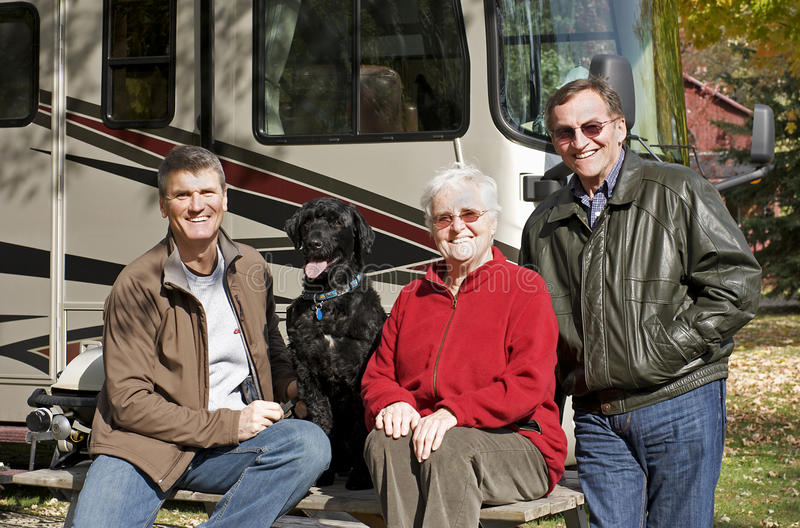 Seniors Camping. A son visits with his in-laws at a RV resort during the fall season