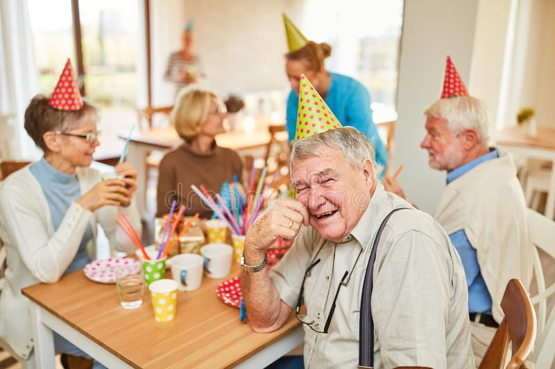 Seniors celebrate their birthday together stock photo
