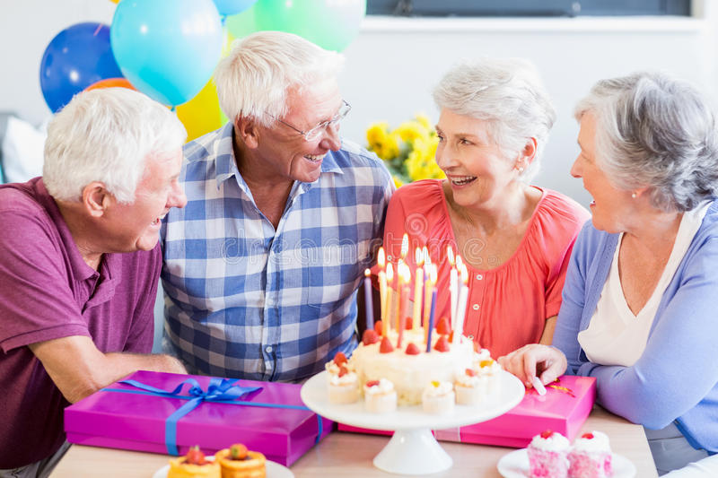 Seniors celebrating a birthday. In a retirement home royalty free stock photography