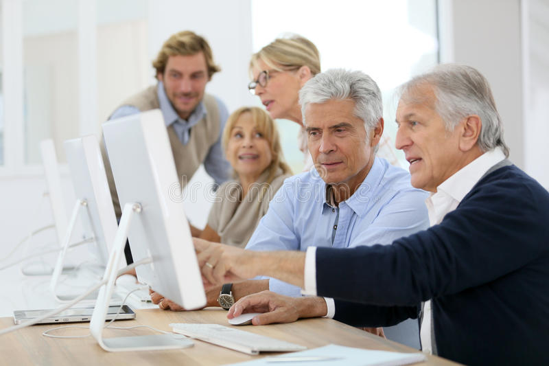 Seniors at computing class royalty free stock images