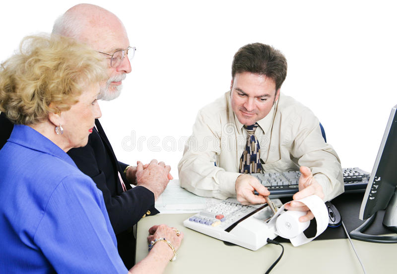 Seniors Consult Tax Accountant. Senior couple consulting an accountant to help with taxes and financial planning. White background royalty free stock photo