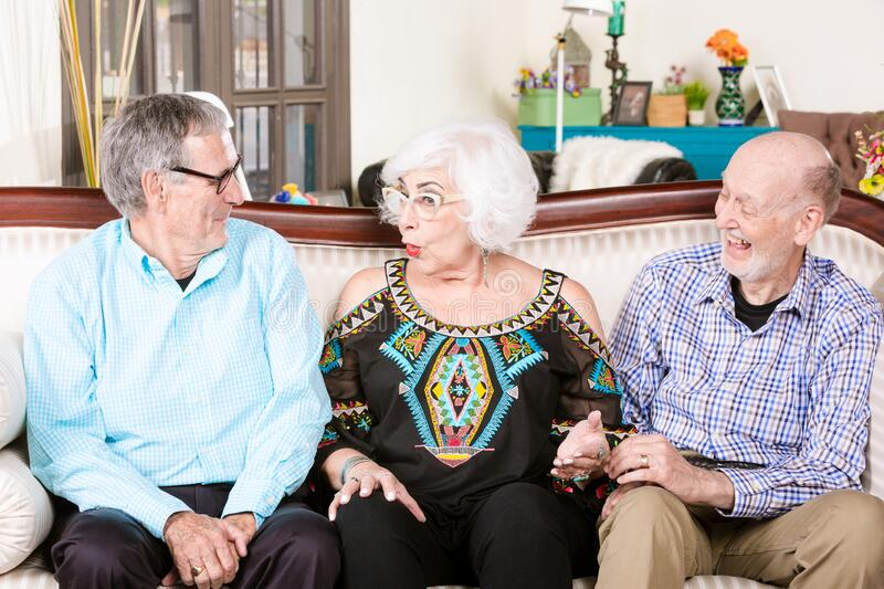 Seniors on a Couch in a home royalty free stock images