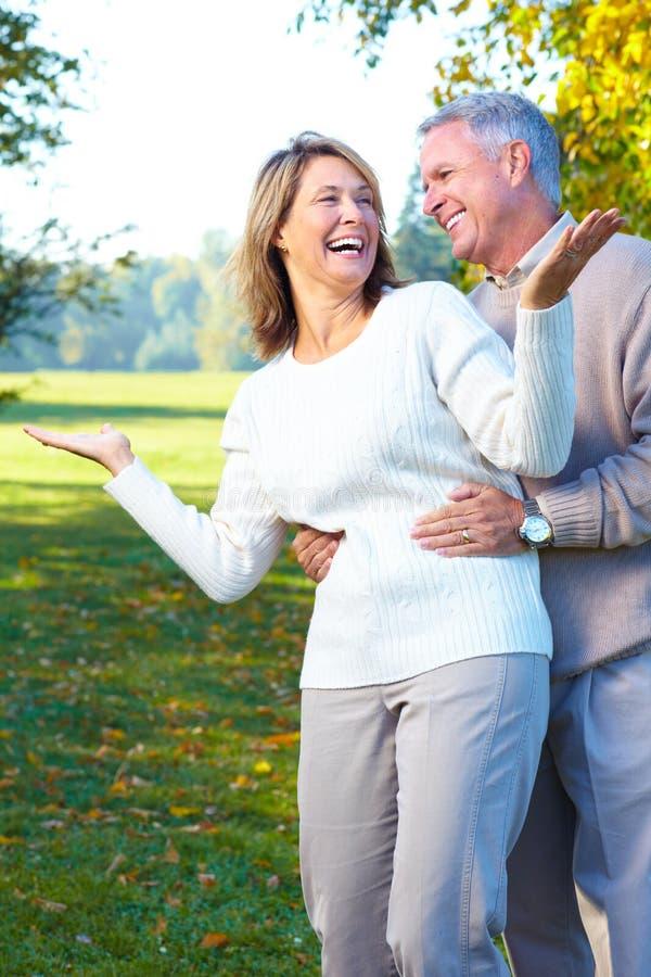 Seniors couple. Happy elderly seniors couple in the forest royalty free stock photos