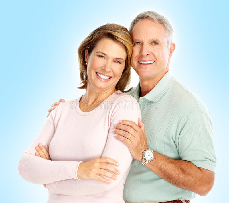 Seniors couple. Happy seniors couple in love. Isolated over white background stock images