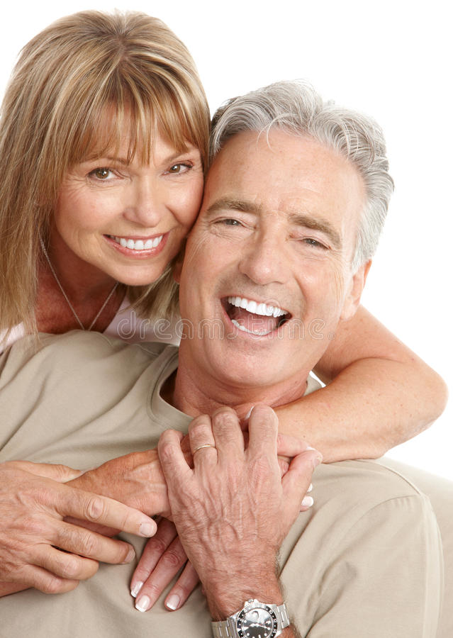 Seniors couple. Happy seniors couple in love. Healthy teeth. Isolated over white background stock image