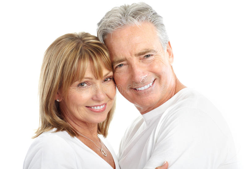 Seniors couple. Happy seniors couple in love. Healthy teeth. Isolated over white background stock photography