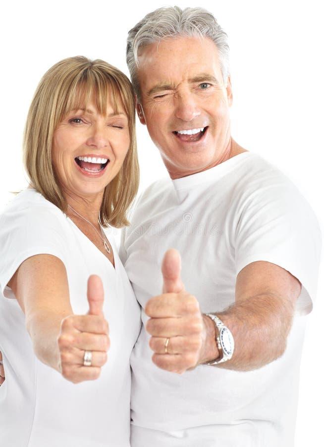 Seniors couple. Happy seniors couple in love. Healthy teeth. Isolated over white background stock photos