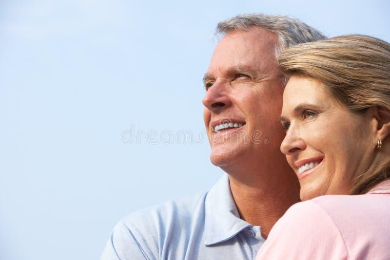 Seniors couple. Happy elderly seniors couple in park stock photo