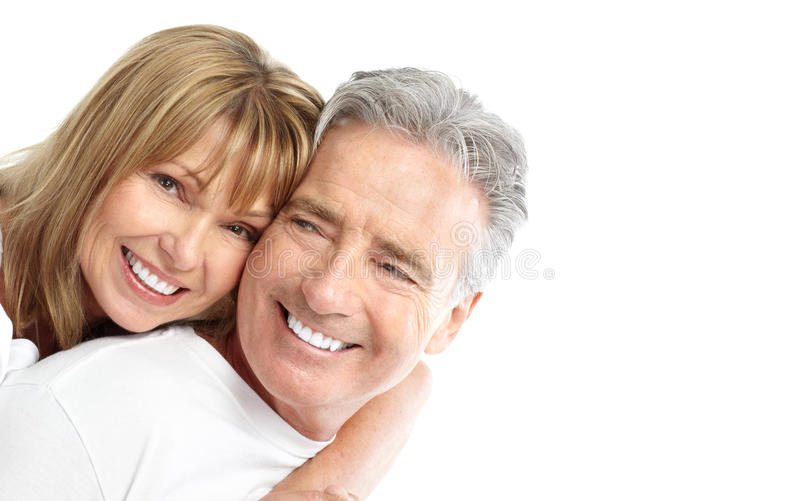 Seniors couple. Happy seniors couple in love. Healthy teeth. Isolated over white background royalty free stock photo