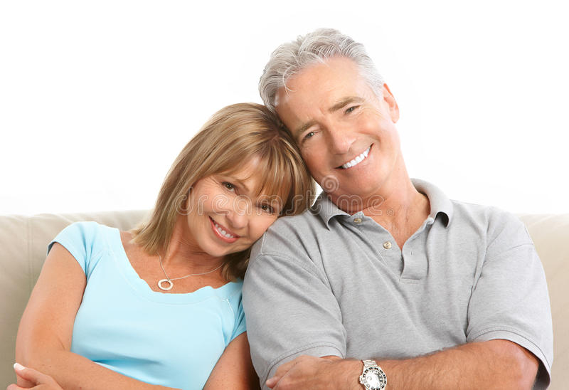 Seniors couple. Happy seniors couple in love. Healthy teeth. Isolated over white background stock images