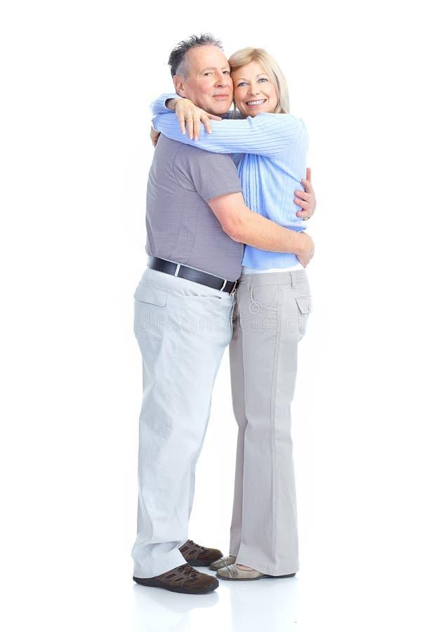 Seniors couple. Happy elderly seniors couple in love. Isolated over white background stock images
