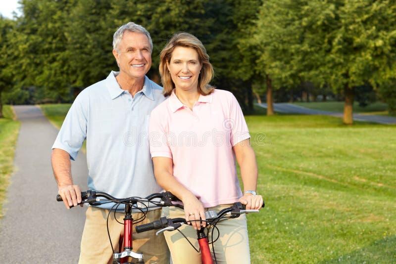 Seniors couple biking stock image