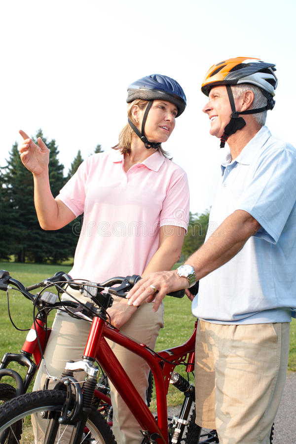 Seniors couple biking stock photos