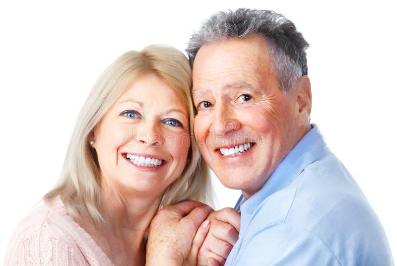 Seniors couple. Happy seniors couple in love. Healthy teeth. Isolated over white background stock photo