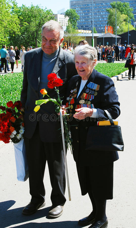 Seniors couple. MOSCOW - MAY 09, 2014: Victory Day celebration in Moscow royalty free stock image