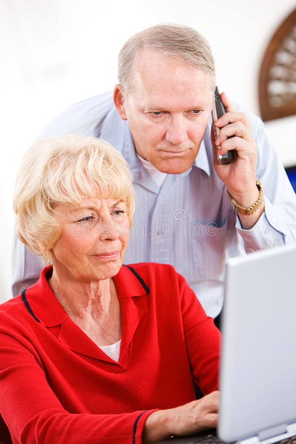 Seniors: Couple On Phone With Tech Support royalty free stock photos