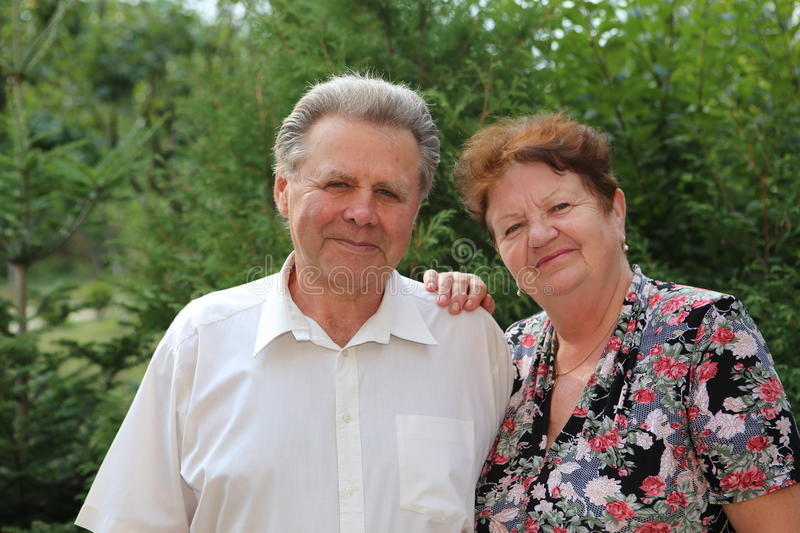 Seniors Couple. Portrait of a grandfather a grandmother in the yard stock photos