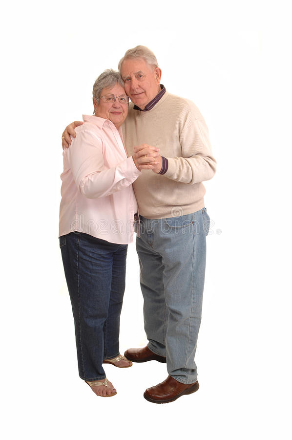 Seniors dancing. A couple of seniors in the sixties dancing in the studio, for white background royalty free stock images