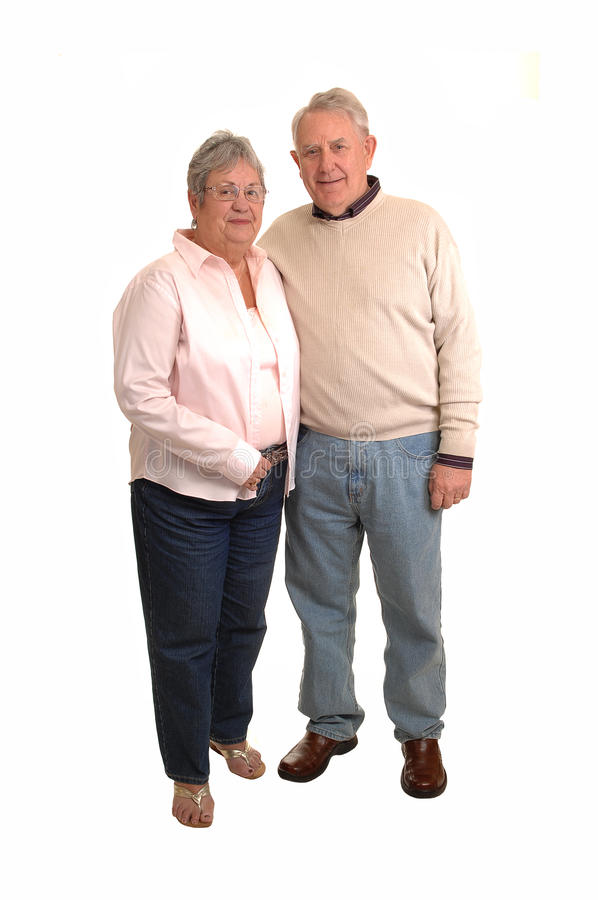 Seniors dancing. A couple of seniors in the sixties dancing in the studio, for white background stock image