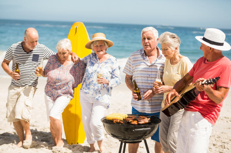 Seniors dancing to the music of a guitar. On a sunny day royalty free stock image