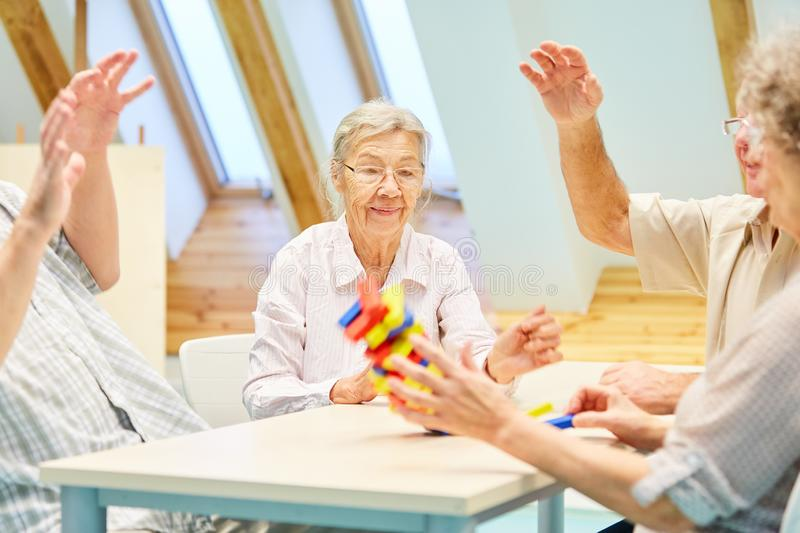 Seniors with dementia play with building blocks royalty free stock image