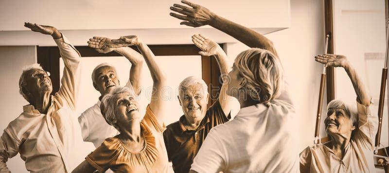 Seniors doing exercises stock photography