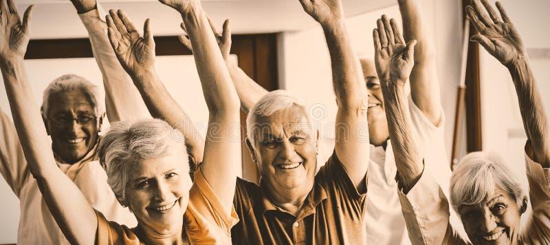 Seniors doing exercises stock image