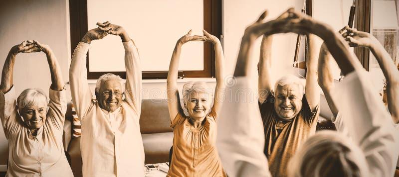 Seniors doing exercises royalty free stock photo