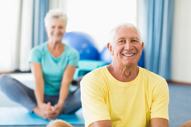 Seniors doing stretching. In a studio stock photography