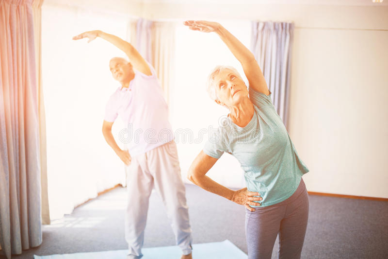 Seniors doing stretching. In studio royalty free stock images
