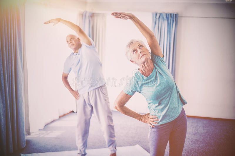 Seniors doing stretching. In studio royalty free stock photos