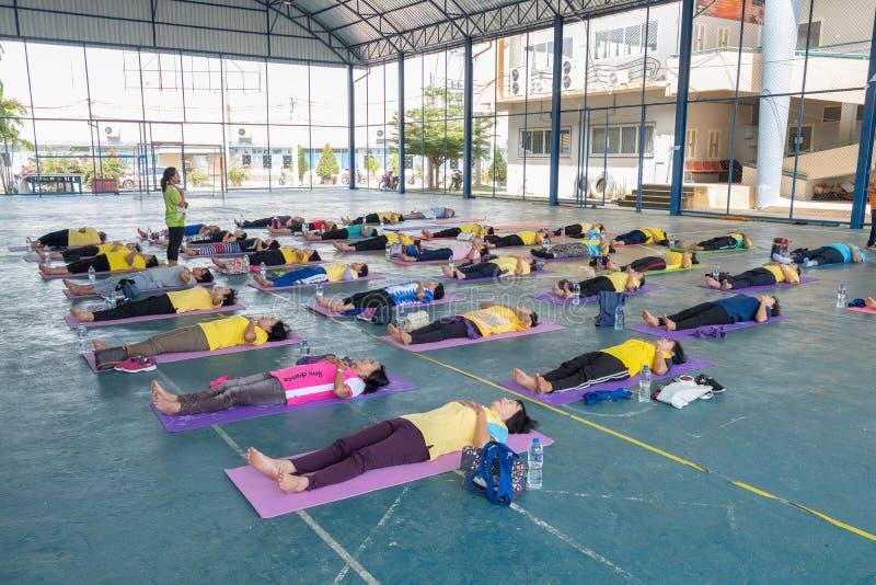Seniors doing yoga exercising stock photos