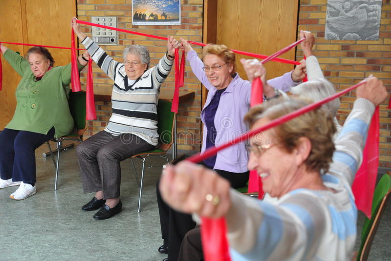 Seniors doings gymnastics stock image