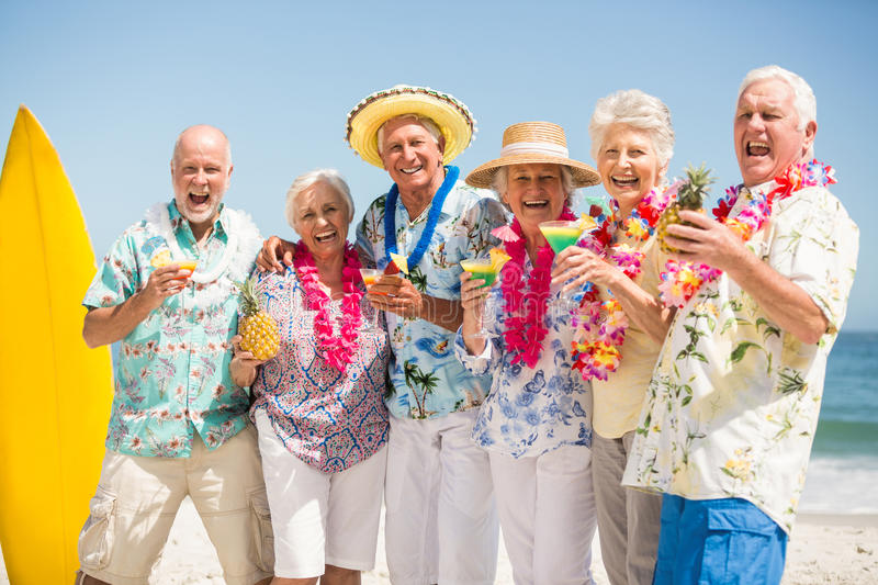 Seniors drinking cocktails. On a sunny day stock photo
