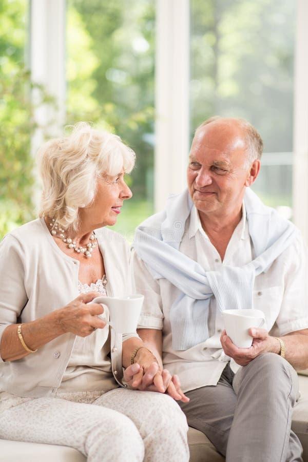 Seniors drinking coffee royalty free stock image