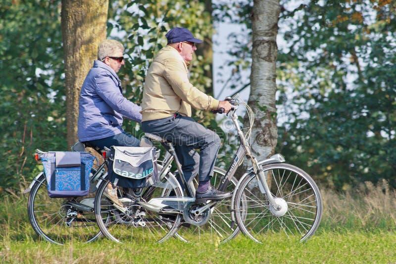 Seniors on e-bikes having a ride, Tilburg Netherlands royalty free stock images
