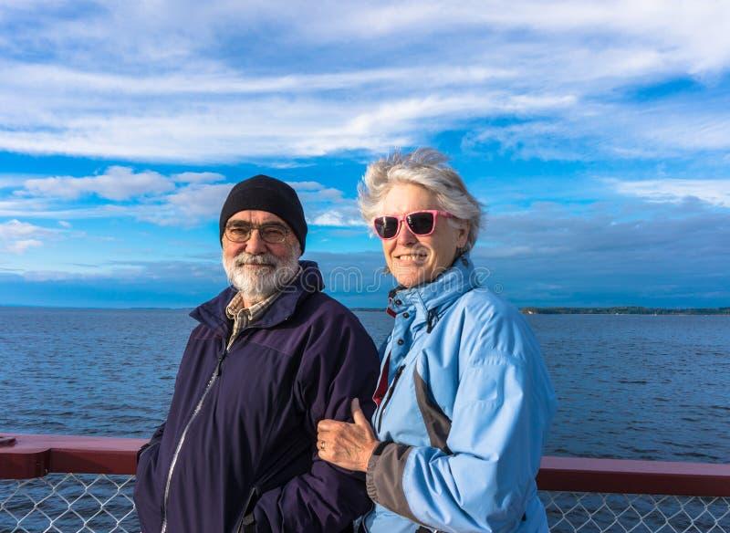 Seniors enjoying the lake on cruise royalty free stock photography
