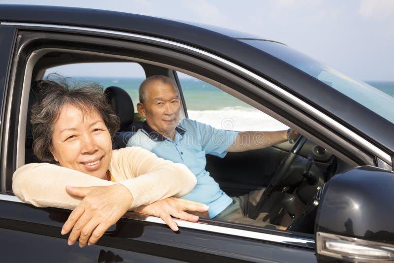 Seniors enjoying road trip and travel. Seniors couple enjoying road trip and travel royalty free stock photo