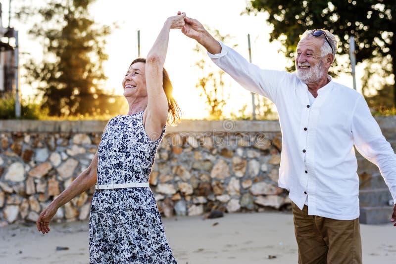 Seniors enjoying a tropical beach stock images