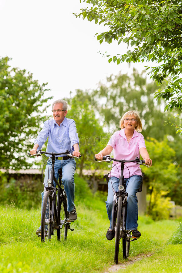 Seniors exercising with bicycle royalty free stock photography
