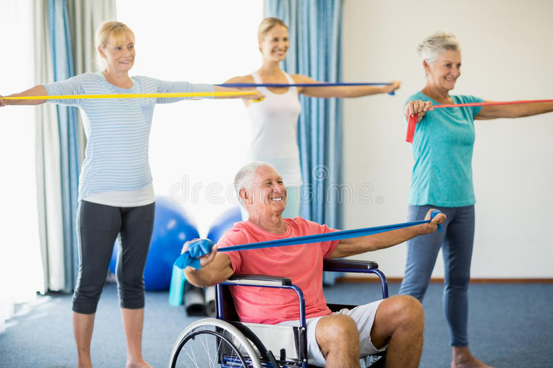 Seniors exercising with stretching bands. During sports class royalty free stock photography