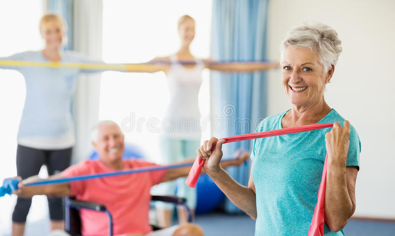 Seniors exercising with stretching bands. During sports class royalty free stock image