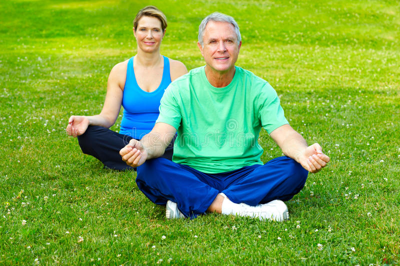 Seniors fitness. Happy elderly seniors couple working out in park stock image