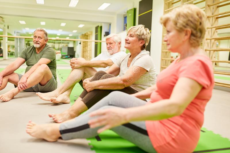 Seniors in a fitness class during a break. Group of seniors in a gym or fitness class in physiotherapy in a break stock image
