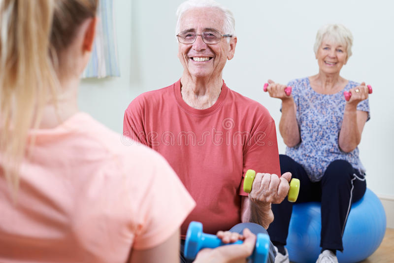 Seniors At Fitness Class With Instructor royalty free stock images