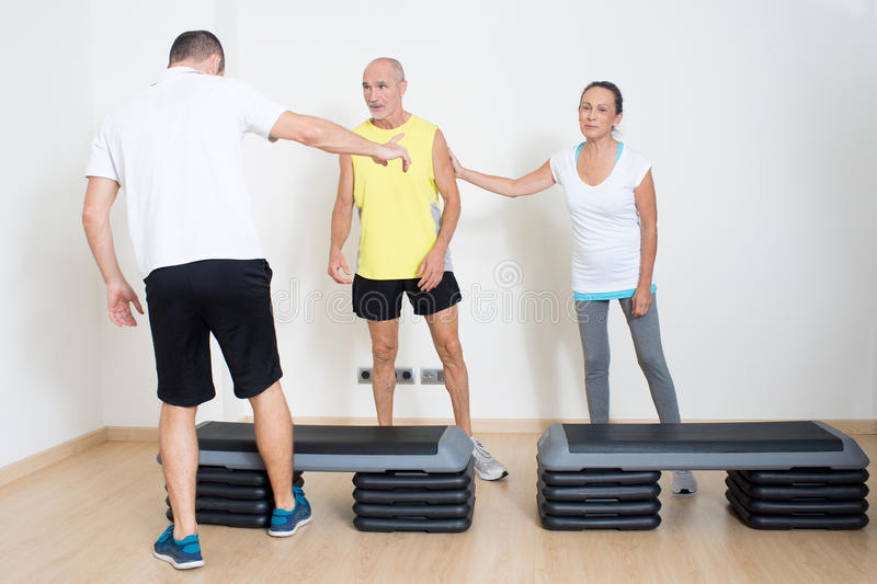 Seniors during fitness exercise. Couple of seniors talking during fitness exercise royalty free stock image