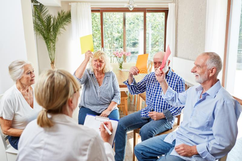 Seniors in a group therapy workshop. Seniors do an exercise together in a group therapy workshop royalty free stock photo