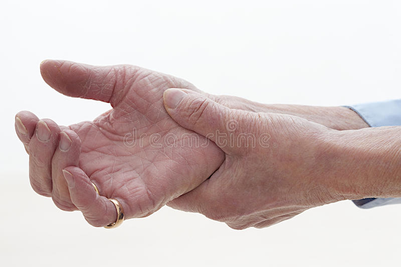 Seniors hands with pain. Hands fisted old person affected by arthritis, rheumatism stock photo
