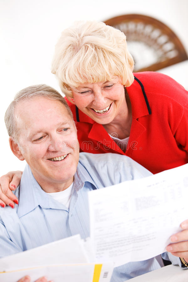 Seniors: Happy To Pay Off Bills royalty free stock images
